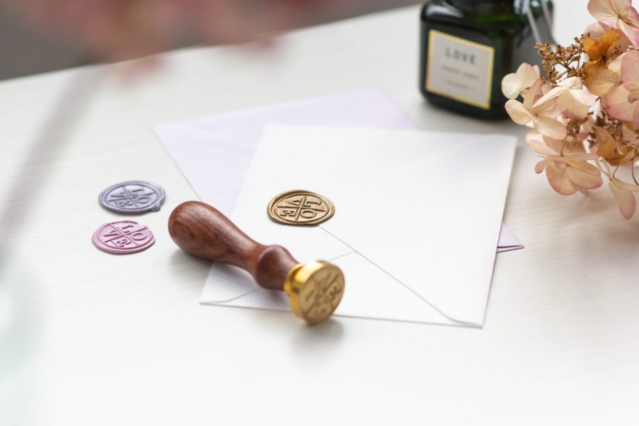 White envelope and gold stamp